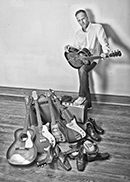 Gregg with guitars and shoes