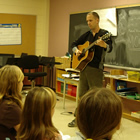 Gregg demonstrates songwriting skills to the class