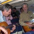 Bob Probert shows Blue Rodeo's Greg Keelor how it's done on the plane  
