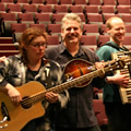 Gregg and the Acoustic Orchestra during the sound check at the Brock University Centre for the Arts, St Catharines. From left to right: Suzie Vinnick, Steve Briggs, Steve Klodt, and a freakishly short-haired Gregg.  (Photo credit: Erin White)