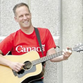 Independent Toronto musician Gregg Lawless with acoustic guitar. (Photo credit: Mike Barrett)